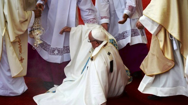 Pope trips, falls during Poland visit