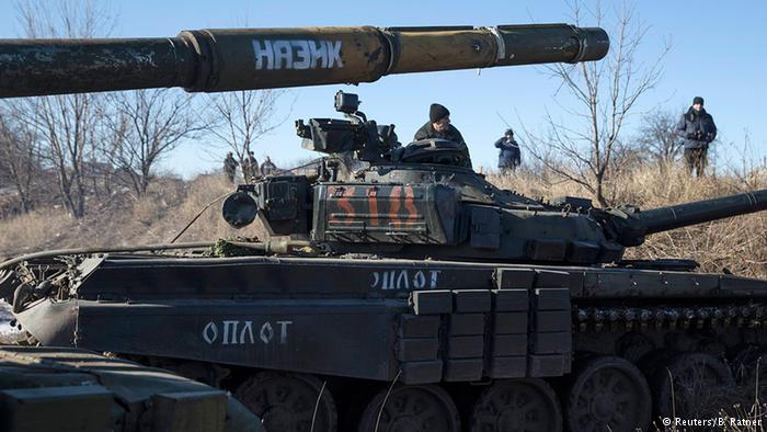 Spain accuses men of fighting with Ukraine separatists