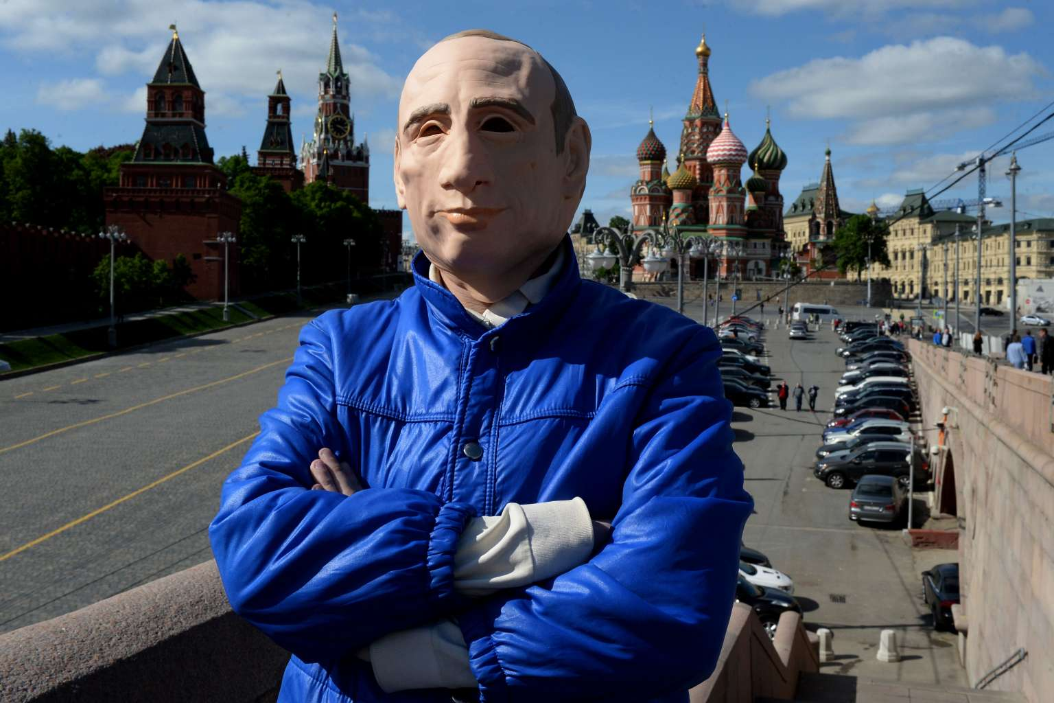 Putin-Mask Protester 'Safe' In Ukraine After Midnight Run From Russia