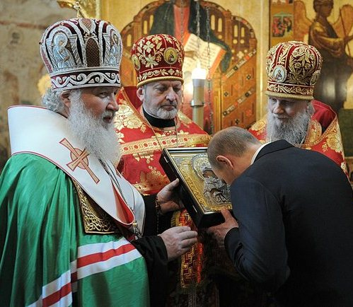 Putin signs law providing state funds for churches, mosques and synagogues