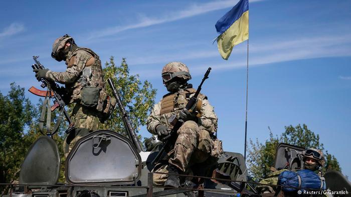 Ukraine approves special status for rebel-held east