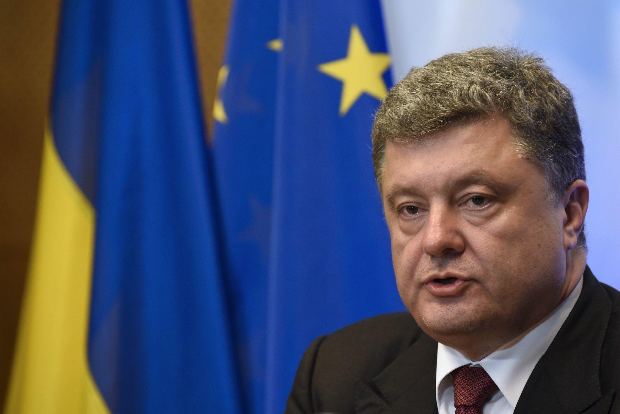As Ukraine talks resume, Putin and Poroshenko trade barbs