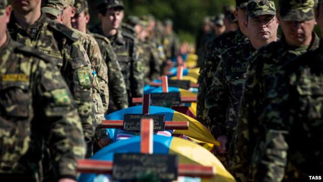 The slow, dangerous work of recovering Ukraine's war dead
