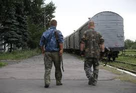 Train carrying bodies of MH17 victims heads across Ukraine